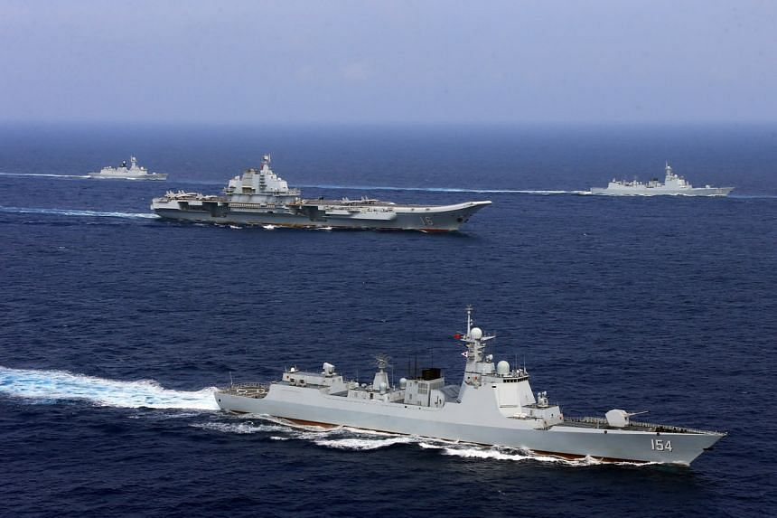 The Chinese aircraft carrier Liaoning (centre) and other ships from the People's Liberation Army Navy taking part in a military drill in the Western Pacific Ocean on April 18, 2018.