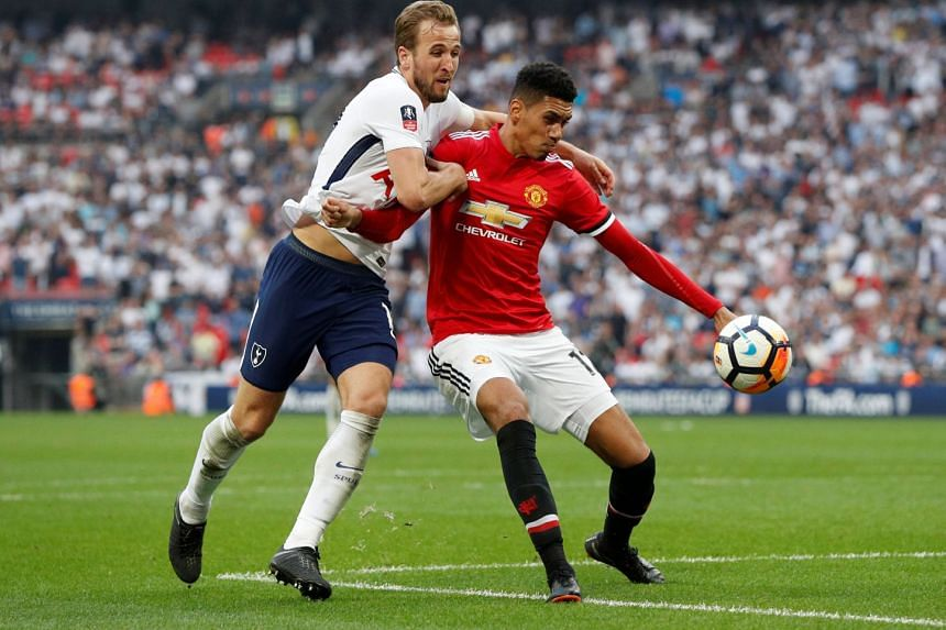 Tottenham Hotspur striker Harry Kane (left) and Manchester United defender Chris Smalling tussling for the ball during their FA Cup semi-final on April 21, 2018.