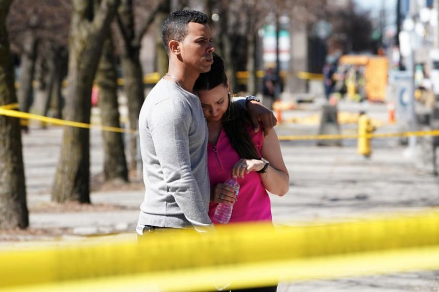 People react to an incident where a van struck multiple people at a major intersection in Toronto's northern suburbs on April 23, 2018.