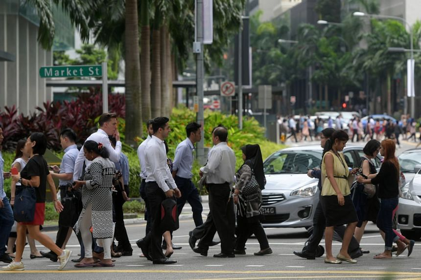 File photo showing a lunch crowd at Singapore's central business district.