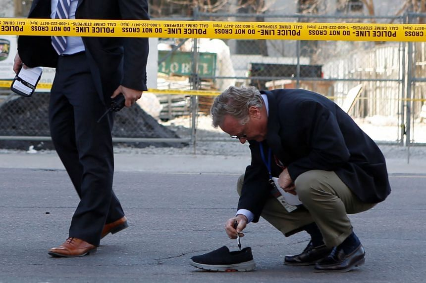 A police detective investigating an incident where a van struck multiple people at a major intersection in northern Toronto, Canada, on April 23, 2018.