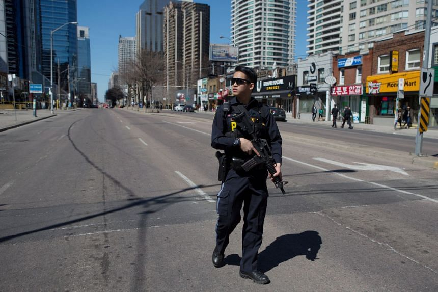 A Toronto police officer responding to an incident where a van struck multiple people at a major intersection in Toronto's northern suburbs on April 23, 2018.