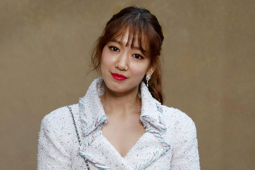 Korean actress Park Shin Hye poses for a photo-call at a fashion show in Paris on March 6, 2018.