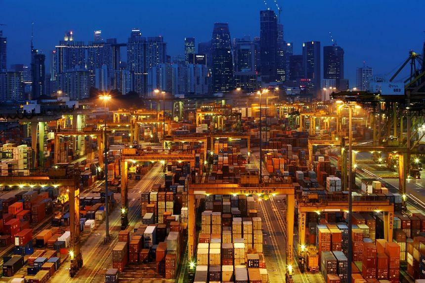 File photo showing a PSA International port terminal in front of Singapore's central business district.
