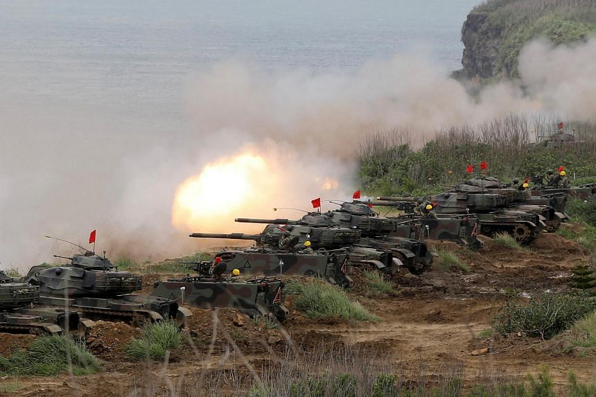 A file photo of M60A3 tanks firing off shells during annual Han Kuang military drill in Penghu, Taiwan, on May 25, 2017.
