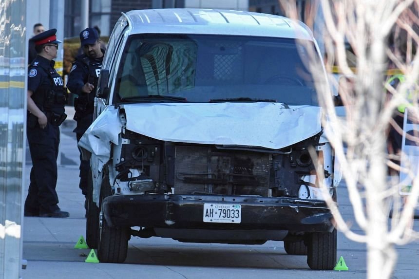 A damaged van seized by police is seen after multiple people were struck at a major intersection northern Toronto, Canada, on April 23, 2018.