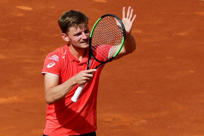 Goffin celebrates winning against Spain's Marcel Granollers.