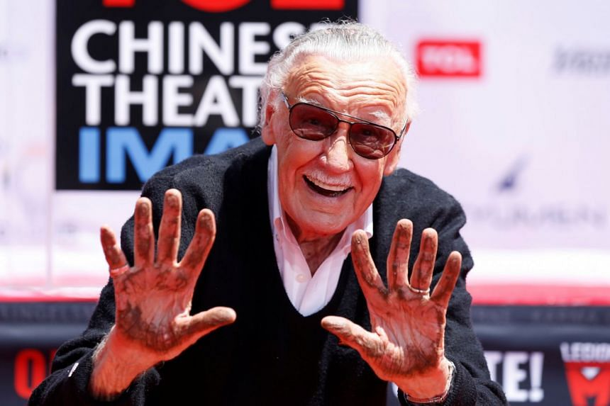 Marvel's Stan Lee shows his hands after placing them in cement during a ceremony on the forecourt of the TCL Chinese theatre in Los Angeles, California, July 18, 2017.