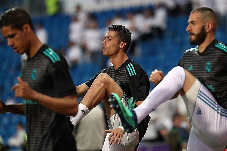 Real Madrid's Cristiano Ronaldo (centre) warming up with Raphael Varane and Karim Benzema before the LaLiga match against Athletic Bilbao last week. Ronaldo scored in the 1-1 draw.