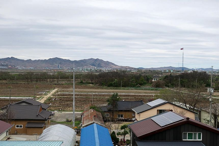 A Grade 3 class at Daeseong-dong Elementary School, which has 35 pupils, some of whom come from the neighbouring town of Munsan. Teenagers must attend school outside the village because there is no middle or high school. A view from the rooftop of Da