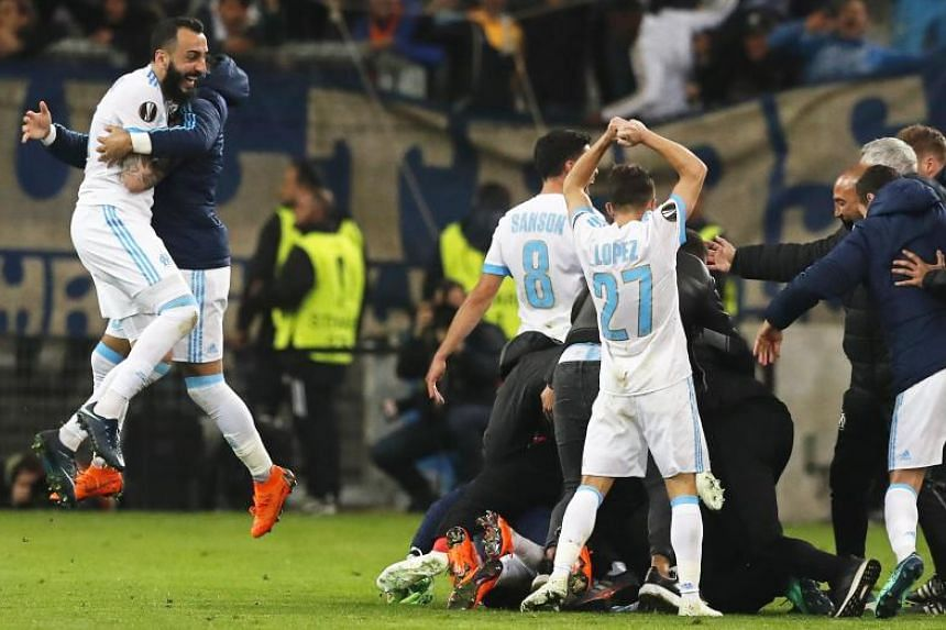 Marseille players celebrate after winning the Uefa Europa League quarter-final match against RB Leipzig on April 12, 2018.