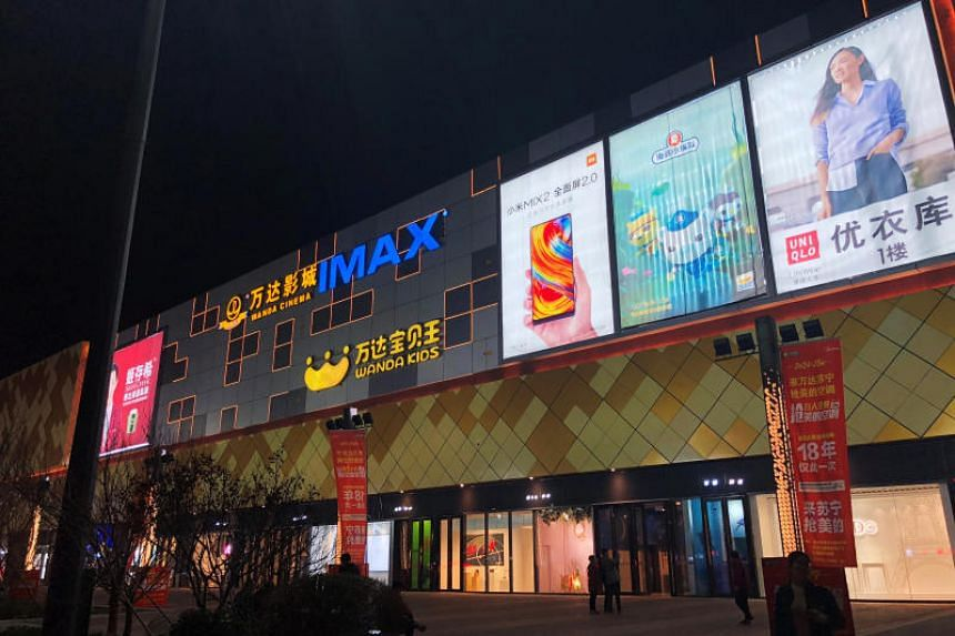 Advertisements are seen on Wanda Plaza in Xinxiang, China, March 23, 2018.