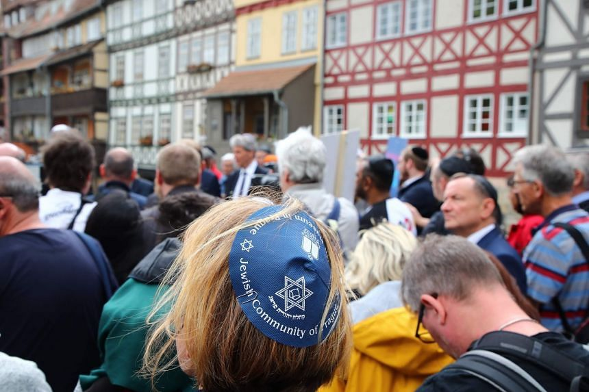 A support rally participant wearing a kippa in Erfurt, central Germany, on April 25, 2018.