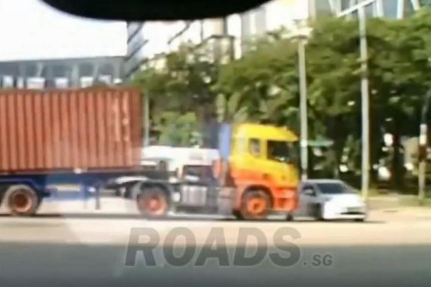 The trailer truck was seen apparently running a red light at the junction, in a video posted on the Roads.sg Facebook page.