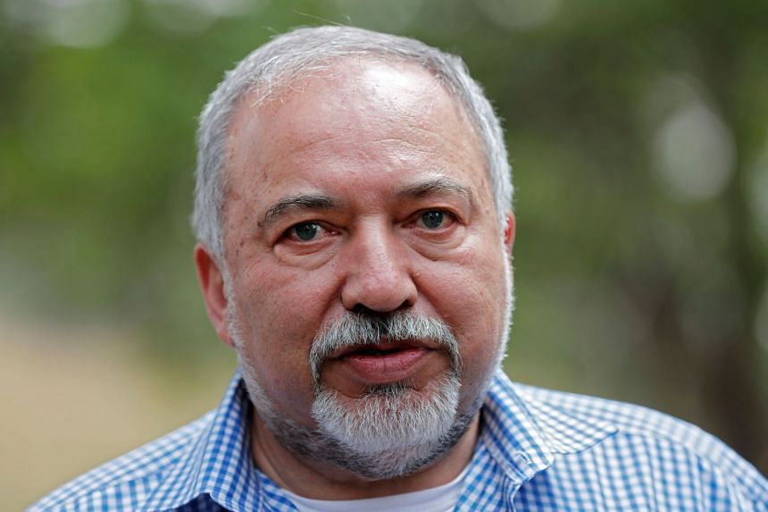 Israeli Defence Minister Avigdor Lieberman (centre) giving a press conference in Nahal Oz on April 20, 2018, near the Israeli border with the Gaza Strip.
