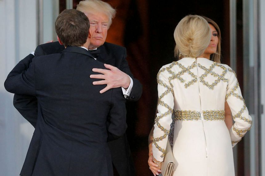 US President Donald Trump and first lady Melania Trump welcome French President Emmanuel Macron and his wife Brigitte for a State Dinner at the White House in Washington, US, on April 24, 2018. REUTERS