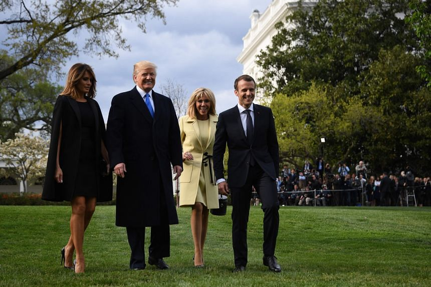 US President Donald Trump and his wife Melania with French counterpart Emmanuel Macron and his wife Brigitte at the White House on Monday. Mr Macron aims to persuade the US leader to preserve the Iran nuclear deal, at least for now.