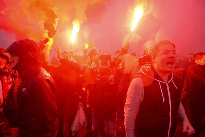 Liverpool supporters cheer ahead of the Champions League semi final against AS Roma.