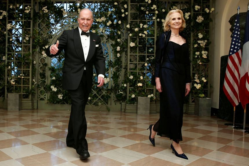Kudlow and wife Judith arrive for a State Dinner in honour of French President Emmanuel Macon at the White House.