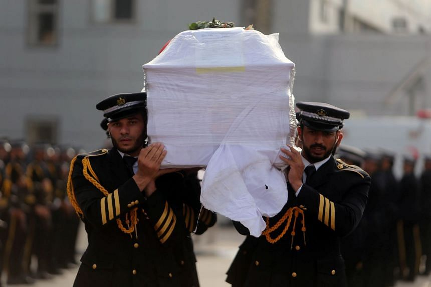 Members of Palestinian Hamas security forces carry a coffin containing the body of Palestinian engineering lecturer Fadi al-Batsh.