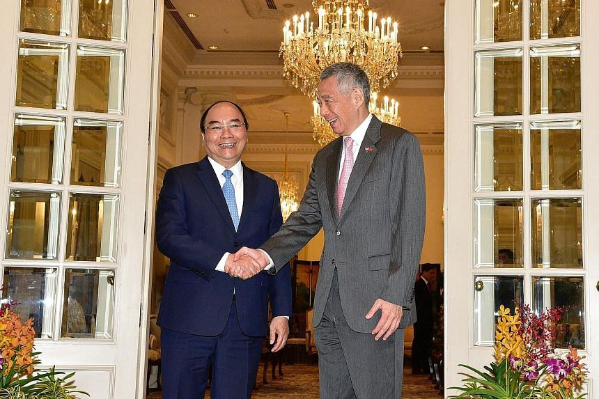 """Vietnamese Prime Minister Nguyen Xuan Phuc with Prime Minister Lee Hsien Loong at the Istana yesterday. Mr Phuc, who is here on a three-day official visit ahead of the Asean Summit this weekend, said: """"Singapore has always been a trusted companion an"""
