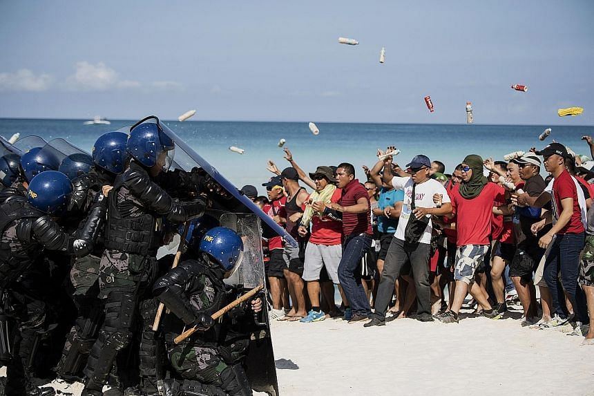 Mock protesters facing off against anti-riot police during a security exercise on the Philippine resort island of Boracay yesterday, ahead of its six-month shutdown and clean-up.