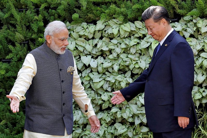 Prime Minister Narendra Modi and President Xi Jinping at a Brics (Brazil, Russia, India, China and South Africa) Summit in Goa, India, in 2016. This week's meeting takes place after a year of fraught ties between the giant neighbours.