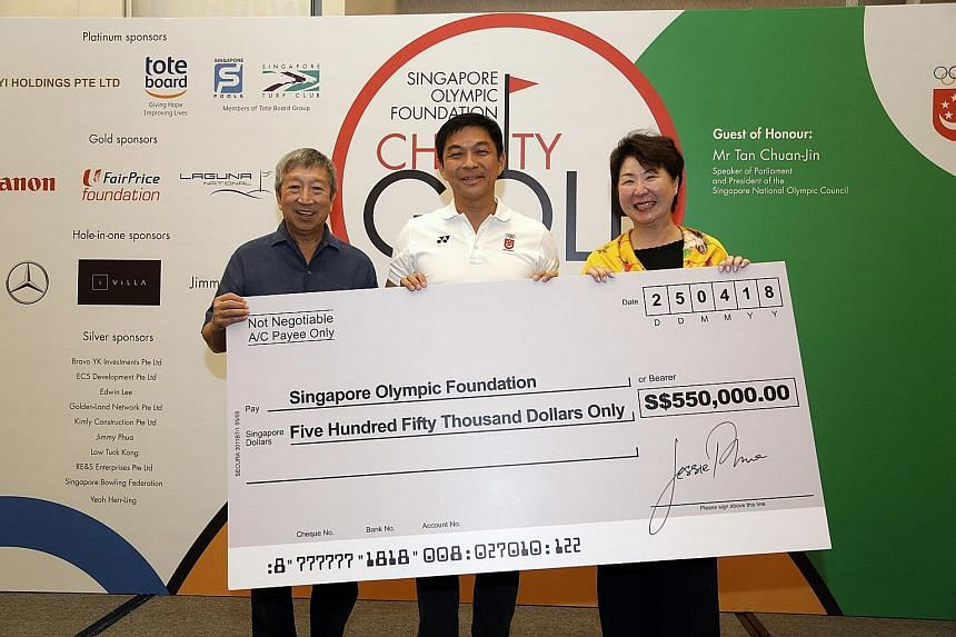 From left: Singapore Olympic Foundation (SOF) chairman Ng Ser Miang with Singapore National Olympic Council (SNOC) president and guest of honour Tan Chuan-Jin and organising committee chairman Jessie Phua at the SOF charity golf event yesterday. The
