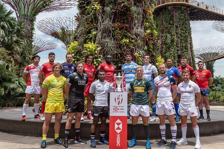 The captains of the 16 teams competing in this weekend's HSBC Singapore Rugby Sevens at the National Stadium posing at the Super Tree Grove at Gardens by the Bay yesterday. Singapore is the eighth leg of the 10-stop HSBC World Rugby Sevens Series, wi