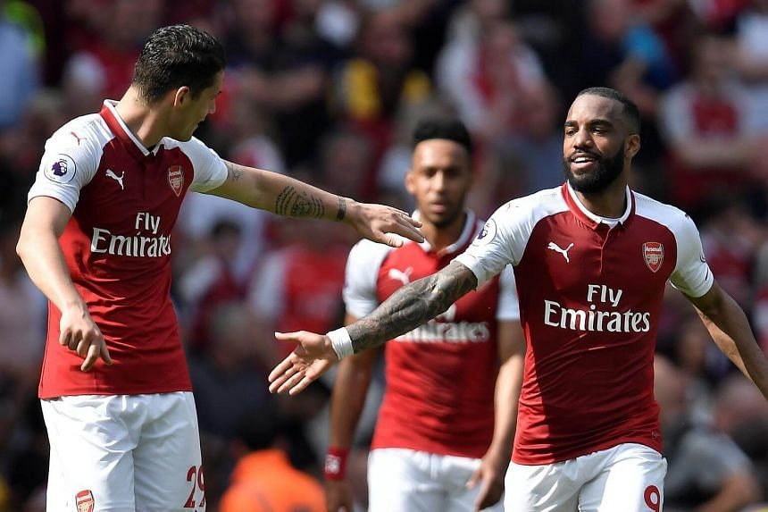 Arsenal's Alexandre Lacazette (right) celebrates with Granit Xhaka after scoring the team's fourth goal against West Ham.