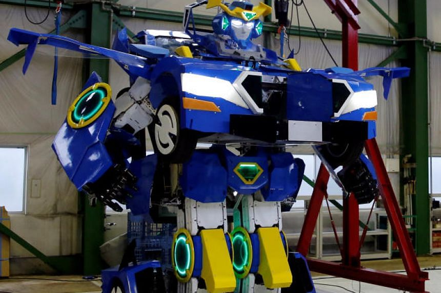 """A new robot called """"J-deite RIDE"""" that can transform itself into a passenger vehicle is unveiled at a factory near Tokyo, Japan, on April 25, 2018."""