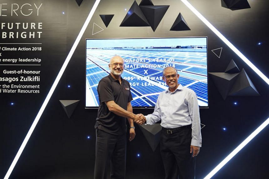 (From left) DBS CEO Piyush Gupta and Minister for the Environment and Water Resources Masagos Zulkifli marking the launch of a solar energy installation at DBS Asia Hub on April 26, 2018.