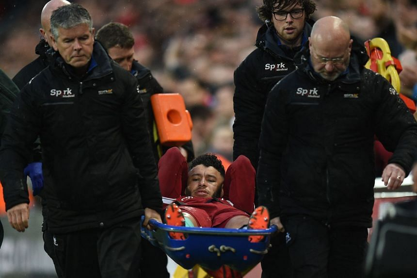Oxlade-Chamberlain is stretchered off the pitch during the Champions League match.