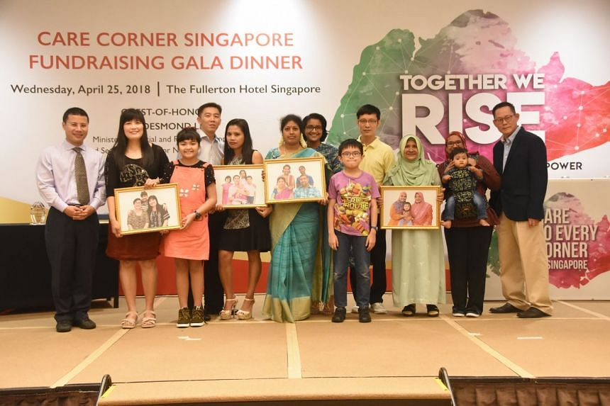 The beneficiaries of Care Corner's Portrait of Love initiative at the fundraising gala dinner on April 25, with Minister of Social and Family Development Desmond Lee (left) as the event's guest-of-honour.