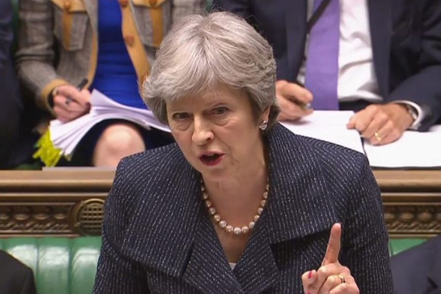 Britain's Prime Minister Theresa May at the weekly Prime Minister's Questions in the House of Commons in central London on April 25, 2018.
