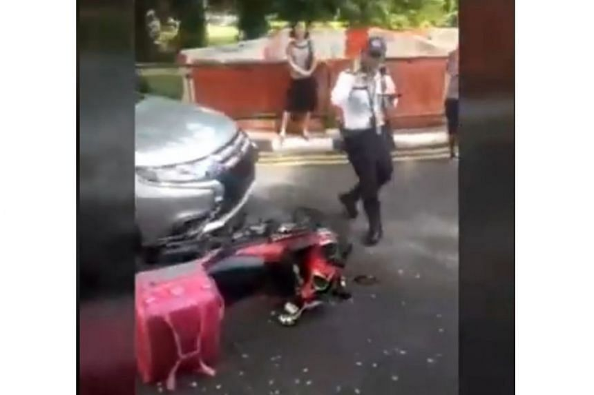In a video at the scene of the accident, the motorcycle, with a pink Foodpanda delivery bag on its rear, could be seen partially wedged under a silver car.
