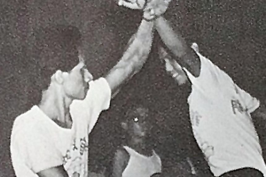 Chia Yan Soon (left) teaching choy li fut with another practitioner at Catholic High School in 1968.