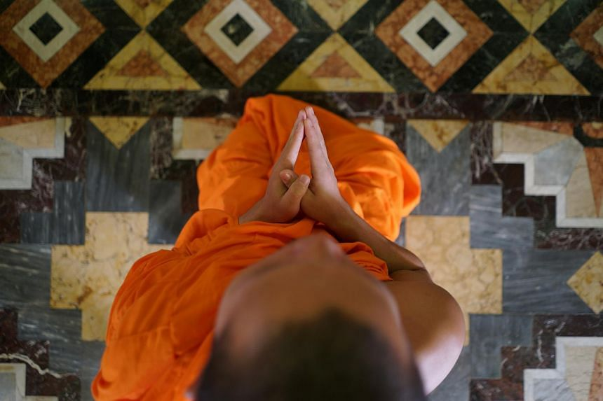 File photo showing a monk praying at a temple in Bangkok, Thailand, on Aug 24, 2017.