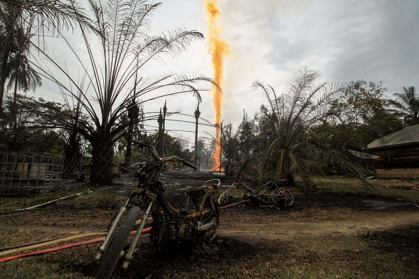 Damaged caused by fire from a burning illegal oil well is seen in Peureulak, Aceh Province, Indonesia, on April 25, 2018.