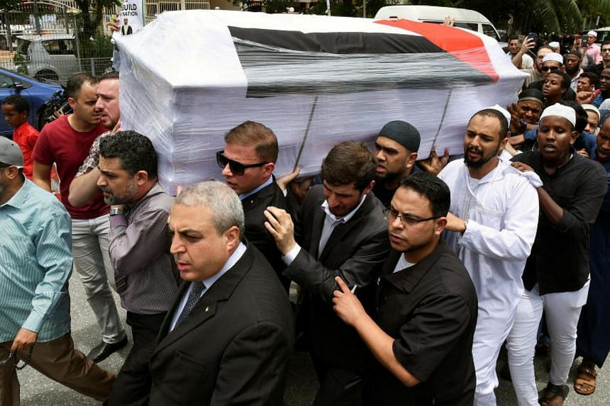 People carrying the coffin of Palestinian man Fadi al-Batsh, who was shot to death, to a mosque for a special prayer in Kuala Lumpur, Malaysia, on April 25, 2018.