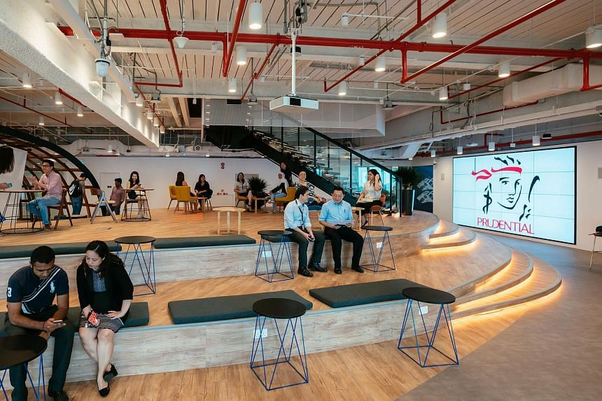 The open amphitheatre area at Prudential's new office, PRU Workplayce, that fosters greater interaction and communication among employees.