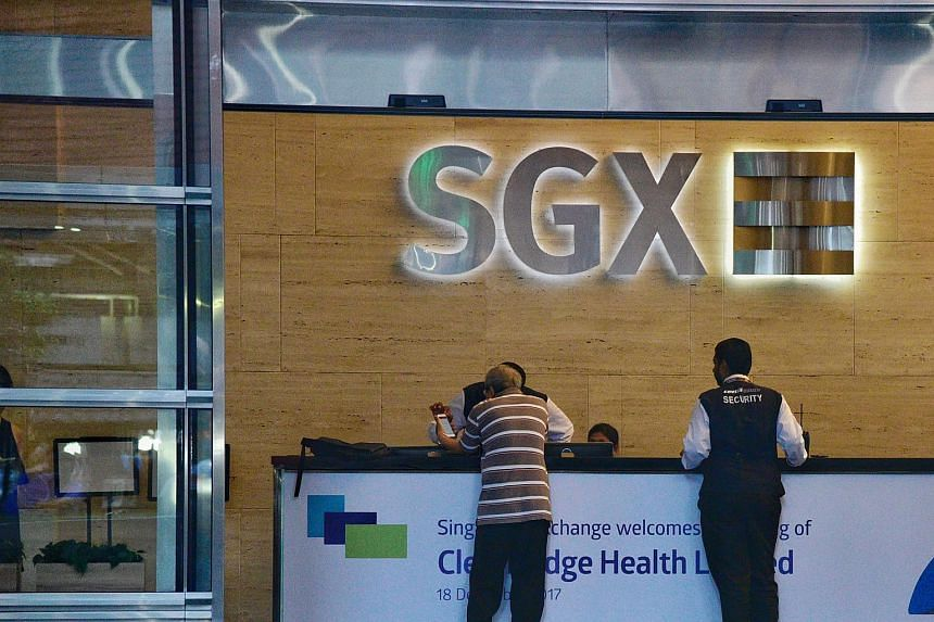 The Singapore Exchange logo above a counter in its building along Shenton Way.