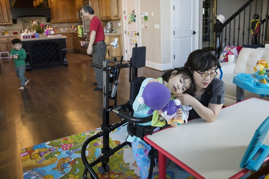 Dr Soo-Kyung Lee with her daughter Yuna in their Oregon home. Balancing the missions of science and motherhood, Dr Lee, who had worked with the FOX family of genes for years, began doing what she was uniquely positioned to do: aiming her research squ