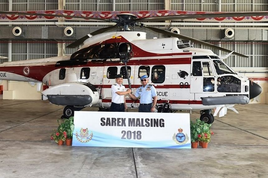 Chief of Air Force Major-General (MG) Mervyn Tan (left) and Chief of the RMAF General (GEN) Tan Sri Dato' Sri Hj Affendi bin Buang co-officiating at the opening ceremony of Sarex Malsing on April 25, 2018.