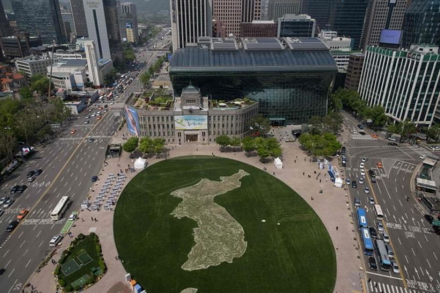 A map of the Korean peninsula created using flowers by the Seoul city government at Seoul city hall plaza to commemorate the upcoming inter-Korean summit is seen on April 26, 2018.