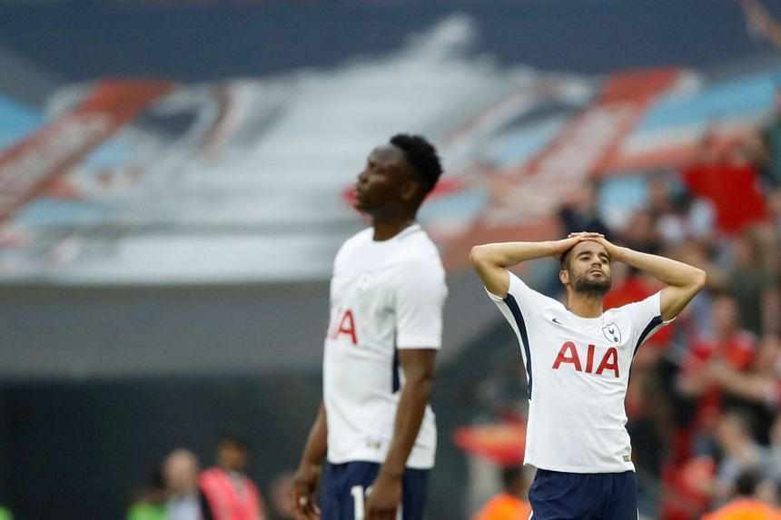 Tottenham's Lucas Moura and Victor Wanyama look dejected after losing in the FA Cup semi-final.