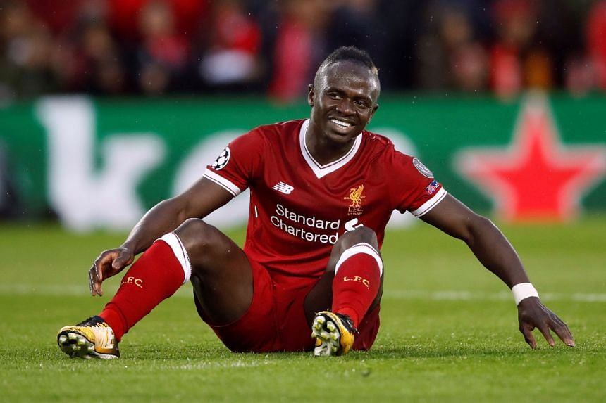 Liverpool's Sadio Mane reacts after missing a chance to score against Roma in the Champions League.