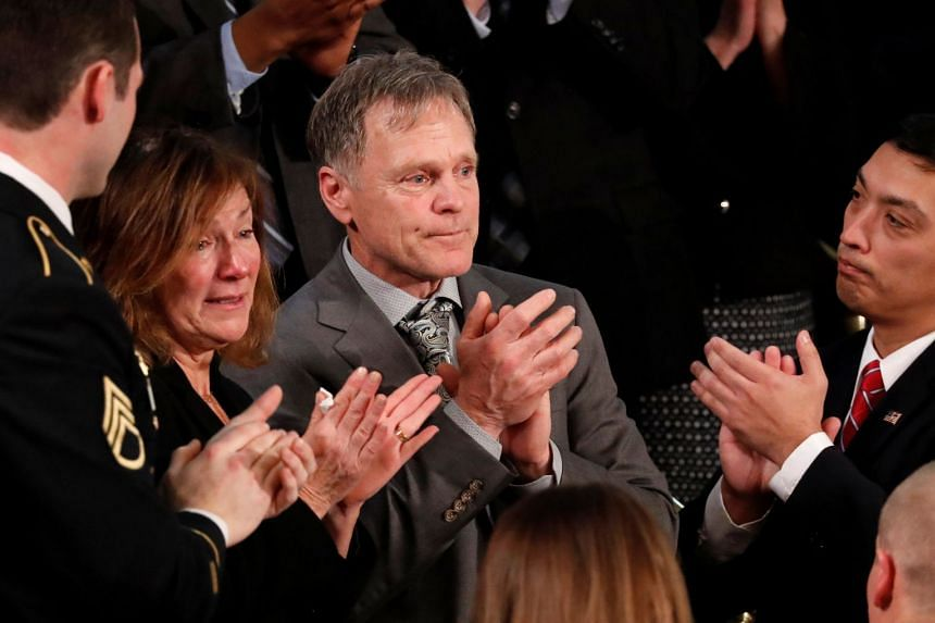 Fred and Cindy Warmbier applaud as Donald Trump talks about the death of their son in his State of the Union address.