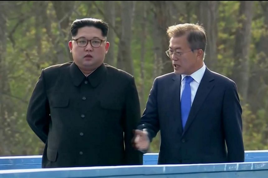 South Korean President Moon Jae In and North Korean leader Kim Jong Un talk during the inter-Korean summit at the truce village of Panmunjom, on April 27, 2018.