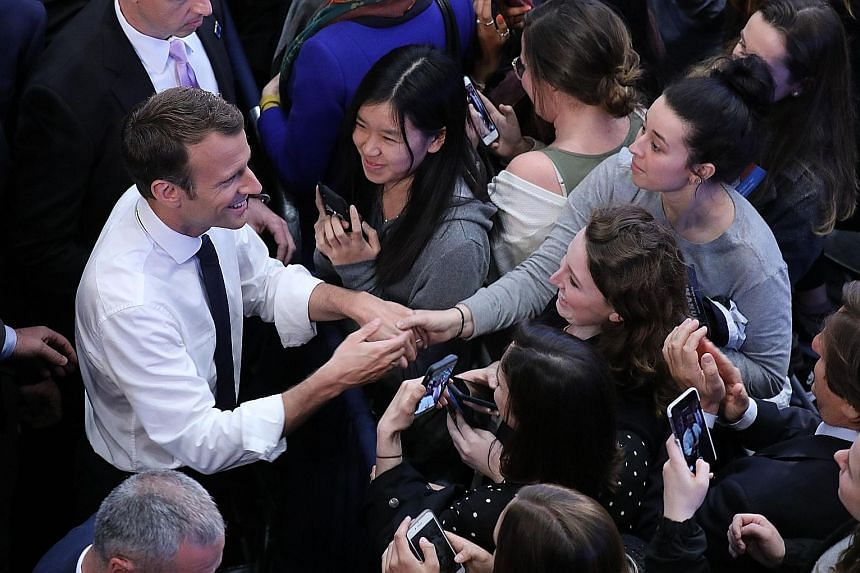 French President Emmanuel Macron meeting students at George Washington University on Wednesday in Washington. Mr Macron argued for preserving the Iran nuclear deal in a speech to the US Congress.